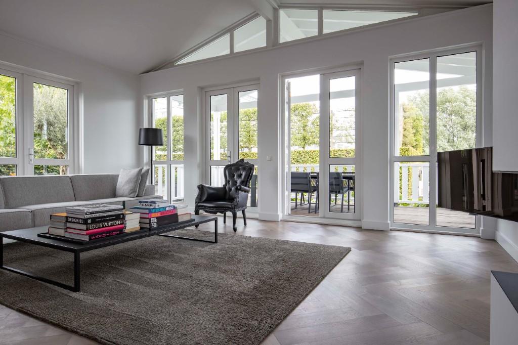 Houten vloeren woonkamer - Woodbyvorselaars
